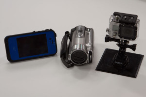 You have choices for video and photos, from the left, an iPhone, small video camera or the most popular device, a GoPro.