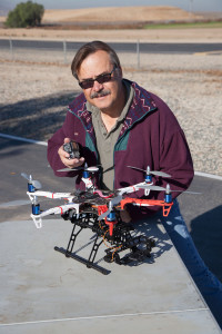 Here the author is detting ready to do some aerial photography by attaching a GoPro camera to the front of this DJI Flamewheel 550.