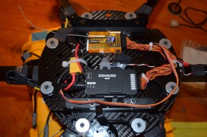 The Zenmuse controller and OrangeRX 9ch receiver are attached to the bottom of the 200mm Vibration Isolation System.