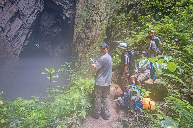 The author flies a DJI Inspire below the first limestone depression inside Son Doong, the world's largest cave. The cave has its own weather system and is very humid.