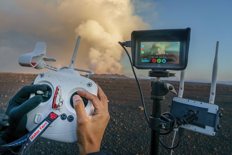 PHOTO BY RAGNAR SIGURDSSON. Eric Cheng flies a DJI Phantom 2 well out of visual range, using a Lightbridge wireless HD video link and Atomos Ninja Blade display and video recorder to monitor his flight. Holuhraun volcano eruption, Bardarbunga volcanic system, Iceland.