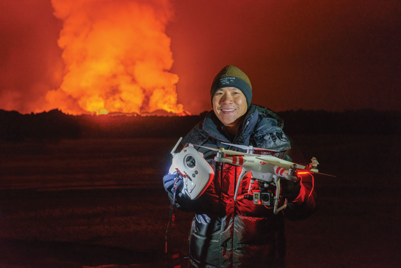 PHOTO BY RAGNAR SIGURDSSON. Eric Cheng, retrieving a DJI Phantom 2 at the Holuhraun volcano eruption, Bardarbunga volcanic system, Iceland. The GoPro camera melted in the intense heat during the flight, and the Phantom returned to launch point using the built-in Return-To-Home feature.