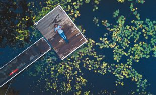 Central Coast, New South Wales, Australia f2.2—1/13s—ISO 200 My mission here was to capture the beautiful contrasting colors and textures of the lily pads, water, and wharf. Hence, I decided to elevate the drone to about 45 to 60 feet as it allowed me encapsulate every part of the scene I wanted to. It also helped me crop out other potential distractions, such as grassy banks, that could have crept into the scene. Cropping out the grassy banks also added a dark sense of mystery. I also tilted the frame by positioning the wharf at 45 degrees just to break the overall horizontality of the composition.